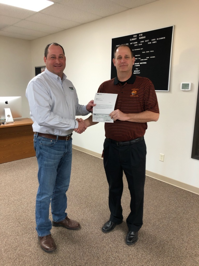 TCEC presents Superintendent of USD218, Rex Richardson with a check for USD218's portion of the TCEC's shares.